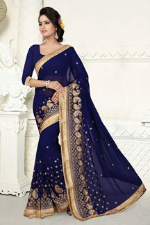 Picture of Stunning blue georgette saree with zari