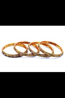 Picture of Artificial pearls worked dull gold bangles