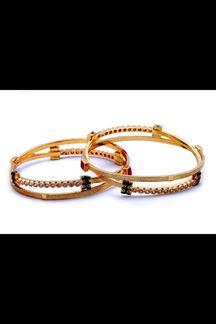 Picture of Unique black & gold designer bangle set