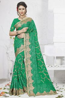Picture of Mesmeric green designer saree with zari