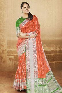 Picture of Bright orange designer saree with zari