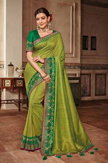 Picture of Attractive green designer saree with zari