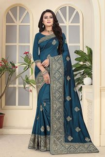 Picture of Scintillating peacock blue designer saree