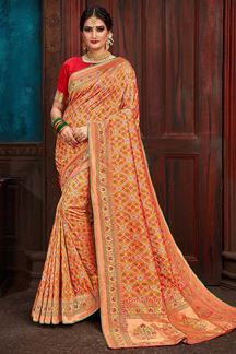 Picture of Appealing orange designer patola saree