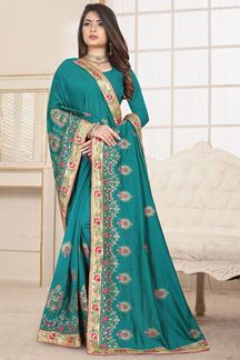 Picture of Prominent Teal Colored party wear Embroidery Saree