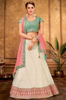 Picture of Intricate Cream & blue Colored Embroidered Raw Silk Lehenga Choli