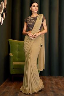 Picture of Innovative Beige & Brown Colored Partywear Lycra Saree