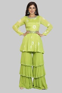 Picture of Parrot Green Colored Peplum Style Gharara Suit