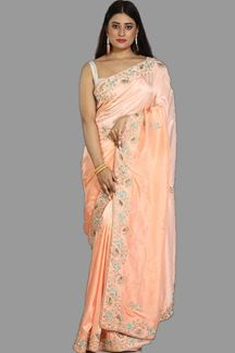 Picture of Surpassing Peach Colored Dola Silk Saree