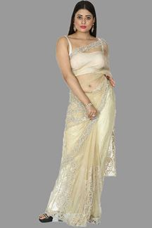 Picture of Flamboyant Beige Colored Partywear Netted Saree