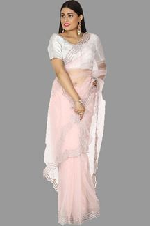 Picture of Gleaming Light Peach Colored Net Saree