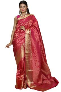 Picture of Flattering Rani Pink Colored Brocade Silk Saree