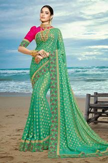 Picture of Intricate Green & Pink Colored Artificial Silk Saree