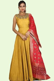 Picture of Gleaming Mustard Yellow Colored Party Wear Silk Anarkali Suit
