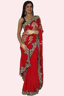 Picture of Gleaming Maroon Colored Party Wear Georgette Saree