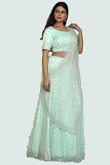 Picture of Appealing Sea Green Colored Partywear Netted Lehenga Choli