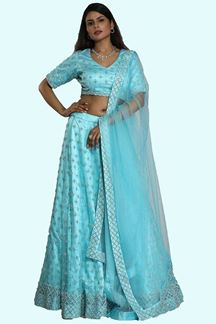 Picture of Dazzling Firozi Colored Party Wear Net  Lehenga Choli