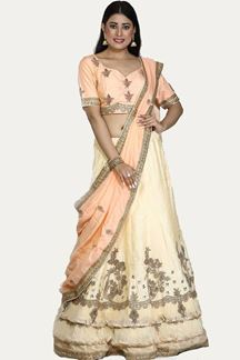 Picture of Entrancing Cream- Peach Colored Wedding Wear Embroidered Silk Lehenga Choli