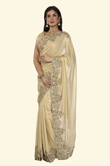 Picture of Flattering Golden Colored Shimmer Silk Saree