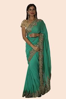 Picture of Magnetic Green Colored Partywear Embroidered Georgette Saree