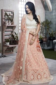 Picture of Flamboyant Peach & Off-white Designer Net Lehenga Choli