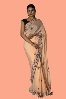 Picture of Dazzling Peach Colored Party Wear Crepe Saree