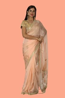 Picture of Appealing Light Peach Colored Partywear Organza Saree