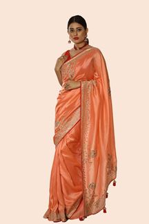 Picture of Intricate Peach Colored Dolla Silk Saree