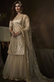 Picture of Dusky Beige Colored Embroidered Net Gharara Suit (Unstitched suit)