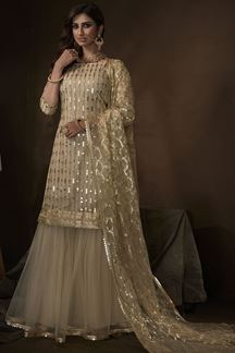 Picture of Dusky Beige Colored Embroidered Net Gharara Suit With Dupatta (Unstitched suit)