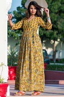 Picture of Yellow Colored Partywear Printed Muslin Kurti