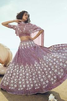 Picture of Exotic Lilac Colored Partywear Embroidered Net Lehenga Choli