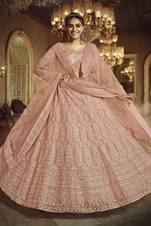 Picture of Glorious Peach Colored Net Lehenga Choli