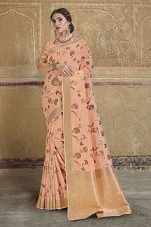 Picture of Beautiful Peach Colored Dola Silk Wedding Saree With Tassels