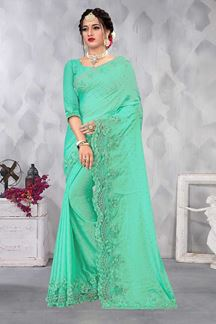Picture of Fashionable Green Colored Party wear Satin Saree
