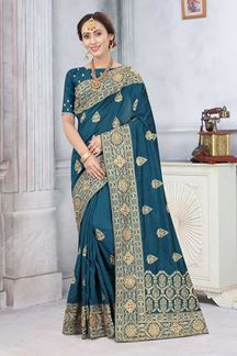 Picture of Peacock Blue Colored Partywear Vichitra Blooming Silk
