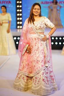 Picture of Magnetic Off-white Colored Wedding Wear Embroidered Lehenga Choli