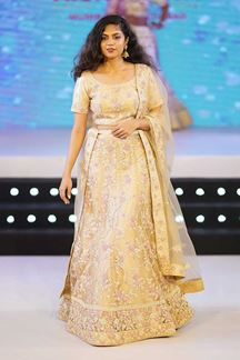 Picture of Breathtaking Golden Colored Partywear Floral Embroidered Netted Lehenga Choli