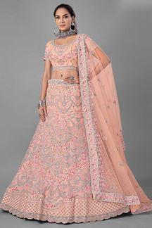 Picture of Beautiful Peach Colored Designer Net Lehenga Choli