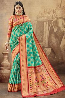 Picture of Eye-catching Teal Blue Colored Silk Saree