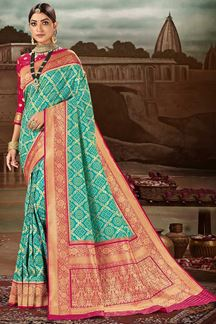 Picture of Magnetic Teal Blue & Pink Colored Festive Wear Banarasi Silk Saree
