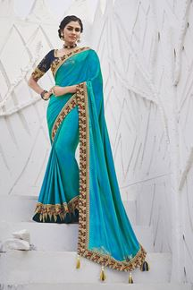 Picture of Gleaming Sky Blue Colored Festive Wear Embroidered Satin Silk Saree