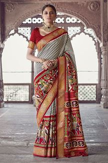 Picture of Energetic Maroon & Cream Colored Patola Silk Saree