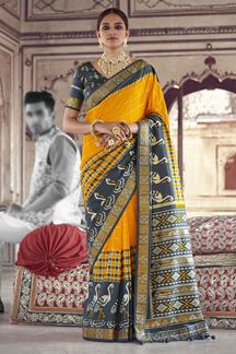 Picture of Glowing Grey & Yellow Colored Patola SilkSaree