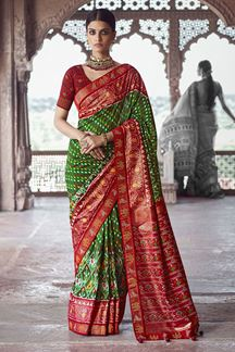 Picture of Groovy Perrot Green & Maroon Colored Patola Silk Saree