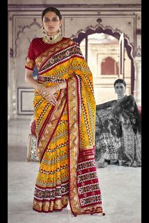 Picture of Prominent Yellow & Maroon Colored Festive Patola Silk Saree
