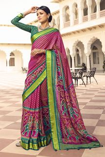 Picture of Magenta Colored Designer Party Wear Brasso Patola Style Saree