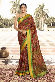 Picture of Maroon Colored Designer Party Wear Brasso Patola Style Saree