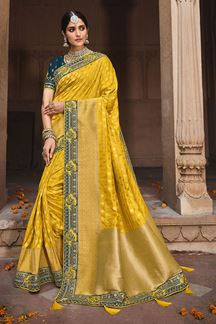 Picture of Entrancing Yellow &  Blue Colored Dola Silk Saree