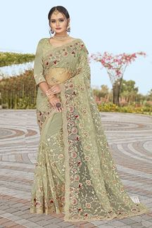 Picture of Dusty Pista Green Colored Partywear Designer Net Saree